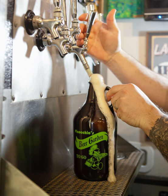 Tap pouring craft beer into a growler