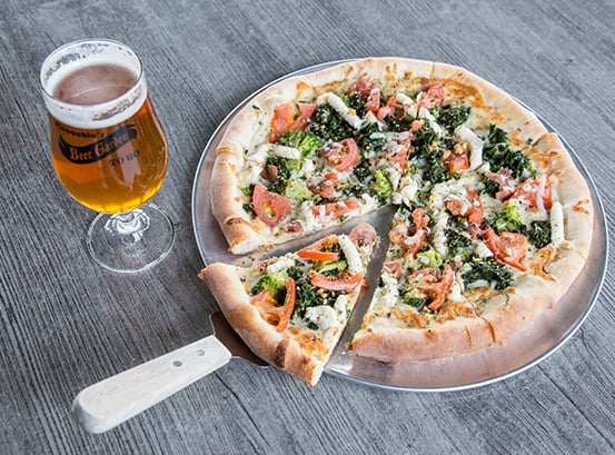 Personal pizza and a glass of beer.